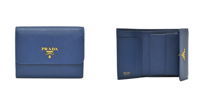 e8888628b381 Saffiano calfskin leather wallet with coin pocket. Signature lettering Prada  logo on front. Full length bill compartment and 2 credit card slots