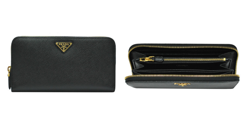 af46ccbb040b Saffiano calfskin leather wallet with zip around closure. Signature  triangle Prada logo on front. Interior compartments with zipped coin pocket